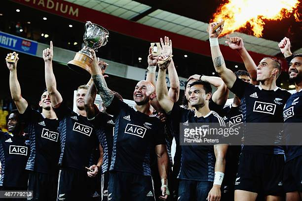 Forbes of New Zealand holds up the Sevens trophy after winning the final match between New Zealand and South Africa at Westpac Stadium on February 8...