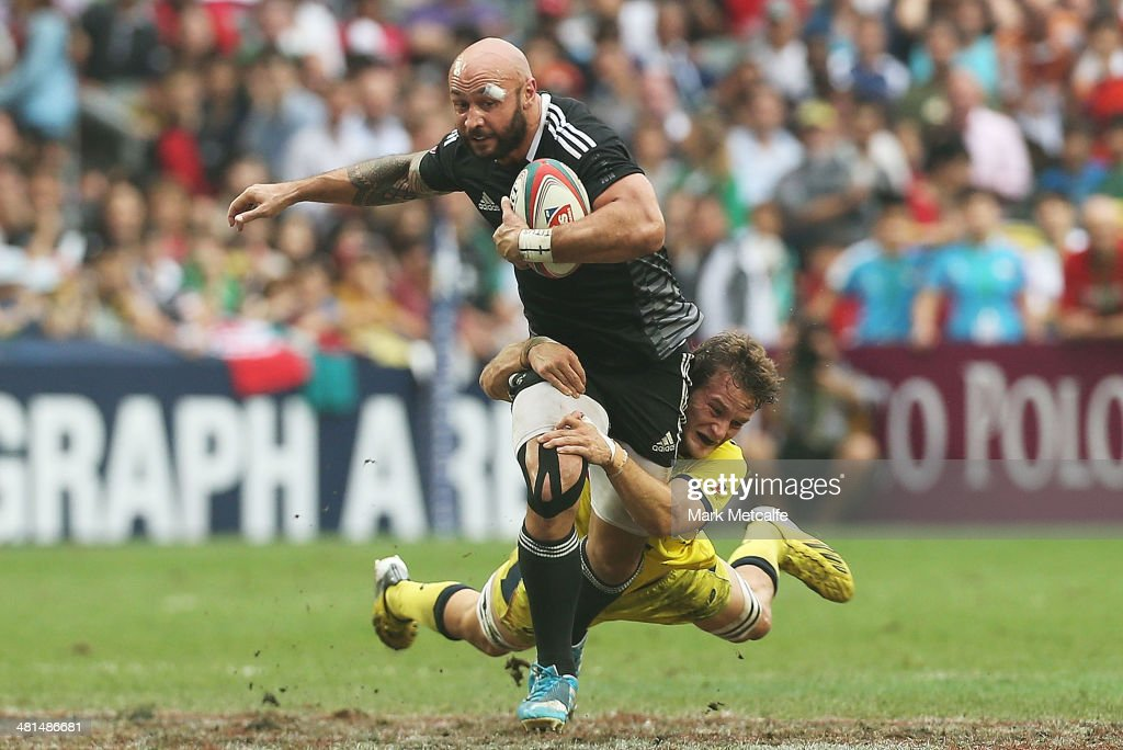Forbes of New Zealand is tackled during the Cup semi-final match between Australia and New Zealand during day three of the 2014 Hong Kong Sevens at Hong Kong International Stadium on March 30, 2014 in Hong Kong, Hong Kong.