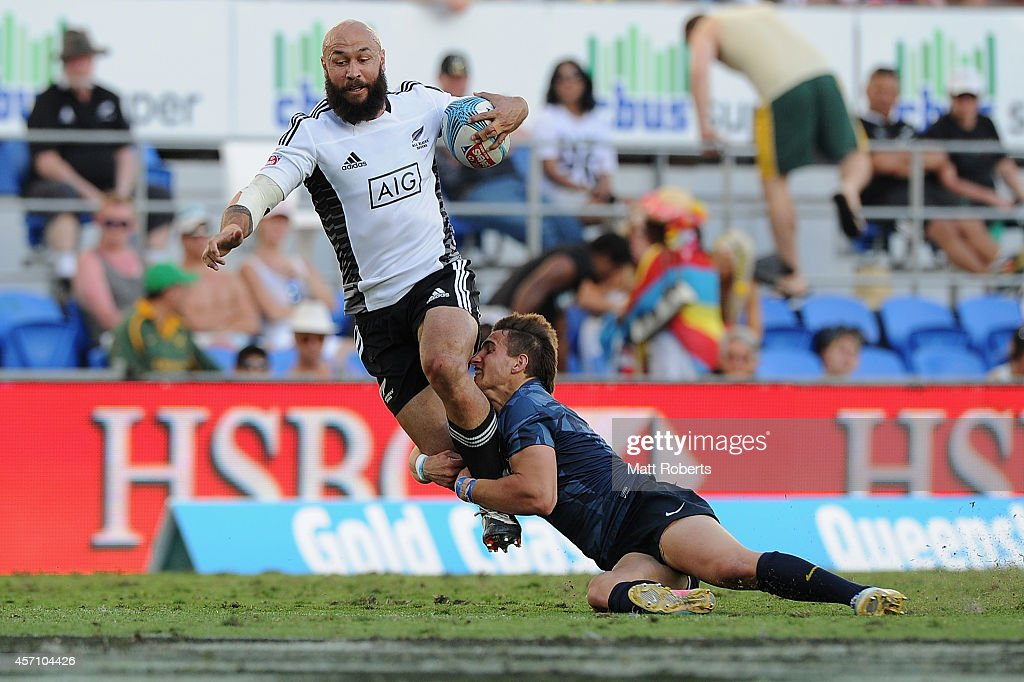 D J Forbes of New Zealand is tackled in the Plate Final against Argentina during the Gold Coast Sevens, the first round of the HSBC Sevens World Series at Cbus Super Stadium on October 12, 2014 on the Gold Coast, Australia.