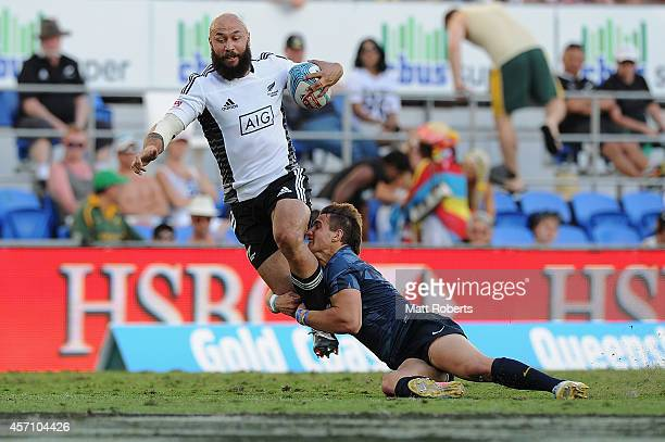 Forbes of New Zealand is tackled in the Plate Final against Argentina during the Gold Coast Sevens the first round of the HSBC Sevens World Series at...