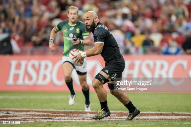 Forbes of New Zealand runs with the ball during the match South Africa vs New Zealand Day 2 of the HSBC Singapore Rugby Sevens as part of the World...
