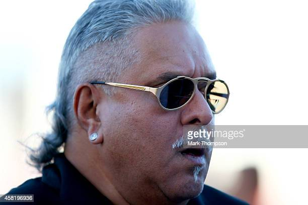 Force India Chairman Vijay Mallya walks along the paddock during practice ahead of the United States Formula One Grand Prix at Circuit of The...