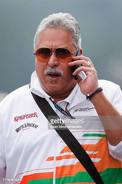 Force India Chairman Vijay Mallya walks in the paddock before the Belgian Grand Prix at Circuit de SpaFrancorchamps on August 25 2013 in Spa Belgium