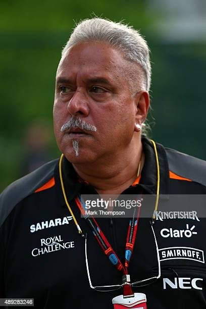 Force India Chairman Vijay Mallya walks in the paddock before the Formula One Grand Prix of Singapore at Marina Bay Street Circuit on September 20...