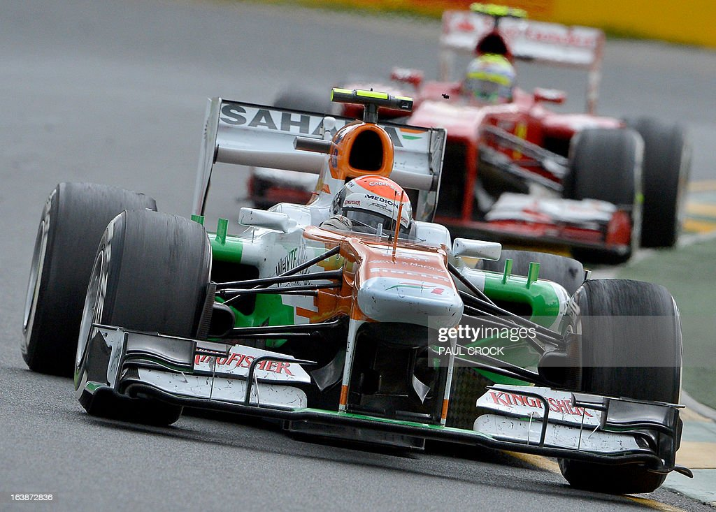 Force India driver Adrian Sutil of Germany powers through a corner during the Formula One Australian Grand Prix in Melbourne on March 17, 2013. IMAGE STRICTLY RESTRICTED TO EDITORIAL USE - STRICTLY NO COMMERCIAL USE AFP PHOTO / Paul CROCK