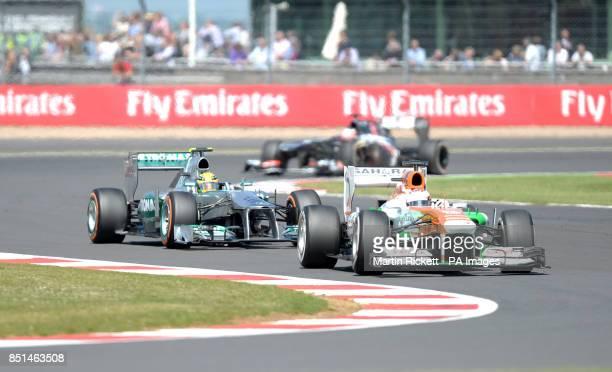 Force India driver Paul Di Resta battles with Mercedes AMG Petronas driver Lewis Hamiltonduring the 2013 Santander British Grand Prix at Silverstone...