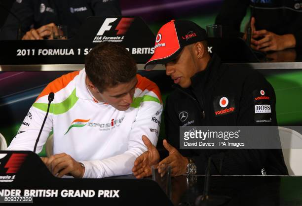 Force India driver Paul di Resta listens to Lewis Hamilton during a press conference on paddock day for the Formula One Santander British Grand Prix...