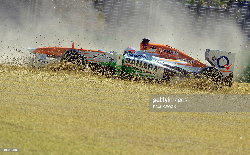 Force India driver Paul Di Resta of Britain kicks up the dust after slamming into a gravel trap during the first practice session for the Formula One Australian Grand Prix in Melbourne on March 15, 2013. AFP PHOTO / Paul CROCK USE