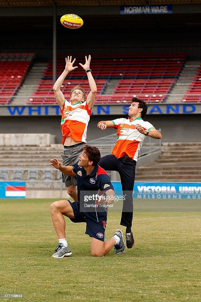 Force India drivers Nico Hulkenberg and Sergio Perez pratice their marking skills on Will Minson of the Western Bulldogs during a meet the drivers session at Whitten Oval on March 11, 2014 in Melbourne, Australia.