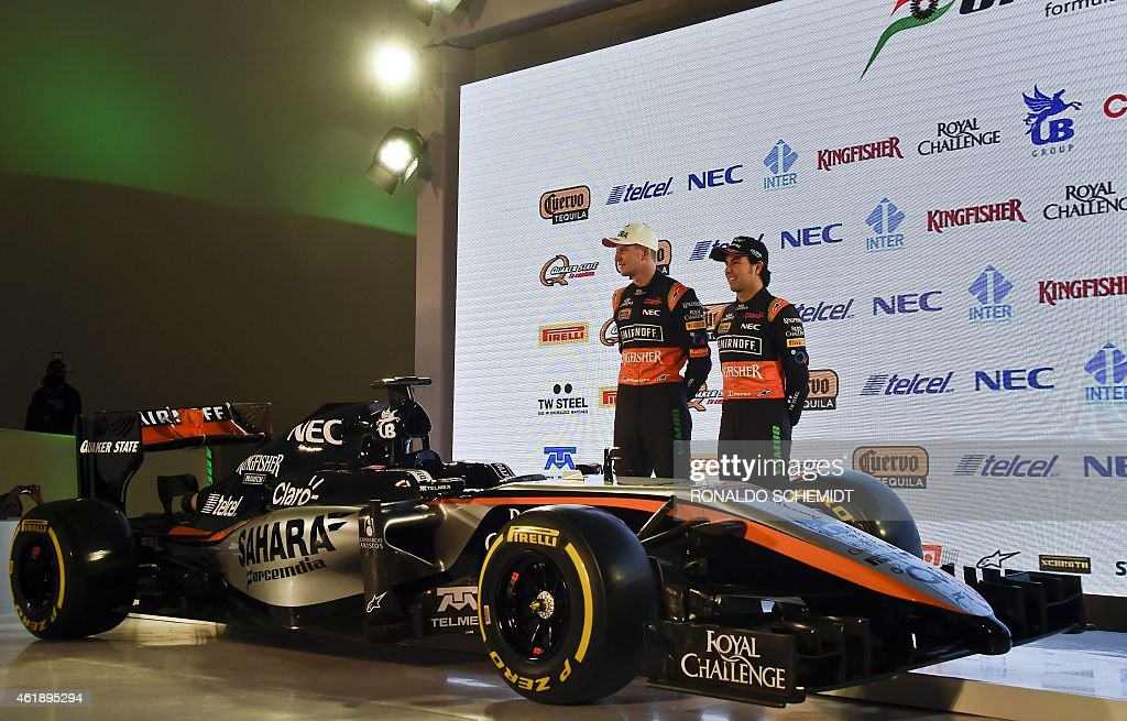Force India drivers Sergio Perez (R) from Mexico and his teammate German Nico Hülkenberg pose next to a Force India Formula 1 Team car with the new team livery that will adorn their cars during 2015 FIA Formula One World Championship is presented at the Soumaya Museum in Mexico City, on January 21, 2015.
