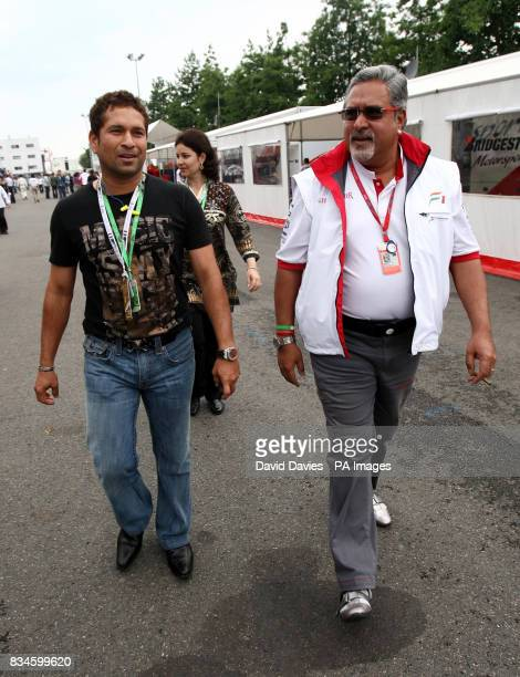 Force India Team Principal Vijay Mallya walks down the paddock with Indian Cricket star Sachin Tendulkar before the Grand Prix at MagnyCours Nevers...
