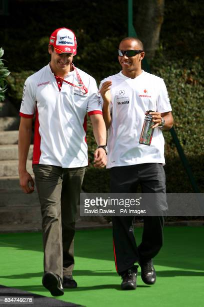 Force India's Adrian Sutil and Vodafone McLaren Mercedes' Lewis Hamilton