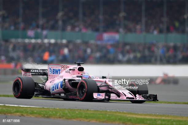 Force India's Mexican driver Sergio Perez drives during the qualifying session at the Silverstone motor racing circuit in Silverstone central England...