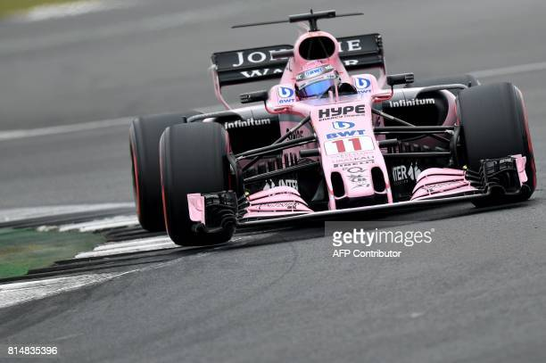 Force India's Mexican driver Sergio Perez drives during the third practice session at the Silverstone motor racing circuit in Silverstone central...