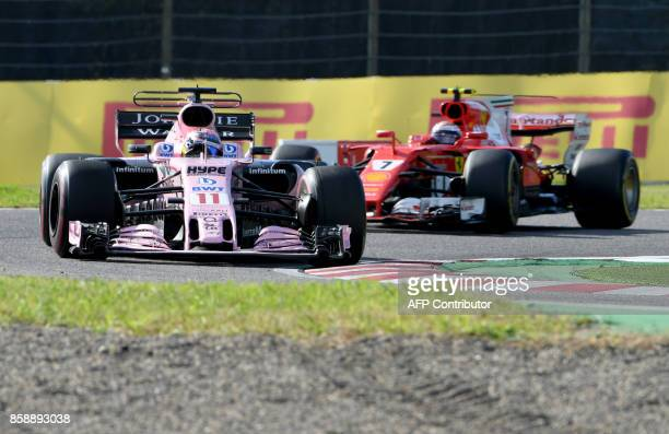 Force India's Mexican driver Sergio Perez leads Ferrari's Finnish driver Kimi Raikkonen during the Formula One Japanese Grand Prix at Suzuka on...