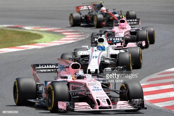 Force India's Mexican driver Sergio Perez Williams' Brazilian driver Felipe Massa and Force India's French driver Esteban Ocon Haas F1's Danish...