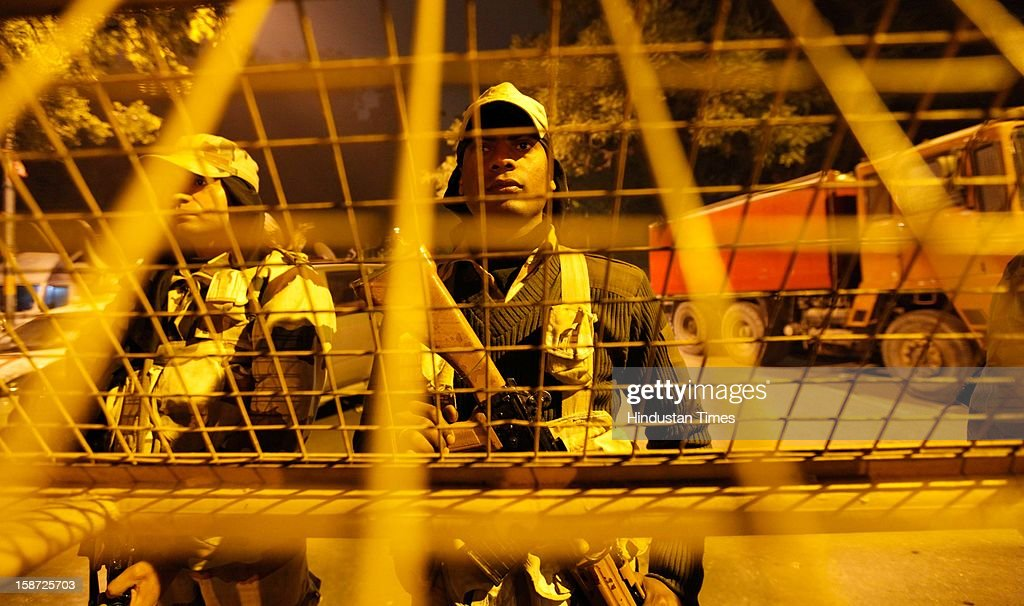 ITBP force on alert in riot gear stand watch at Jantar Mantar following weekend clashes between demonstrators and police on December 26, 2012 in New Delhi, India. Authorities have shut down roads in the heart of India's capital for the second consecutive day to put an end to a week of demonstrations against the gang-rape.