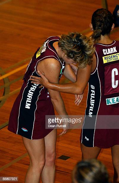Force player Kimberly Horton is held up by her team mate Tempara Clark after she got a knock to the head during the National Bank Netball Cup between...