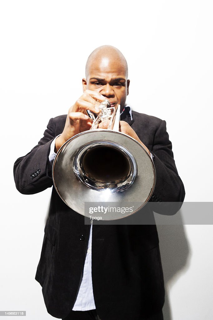 Forced perspective of trumpet player : Stock Photo