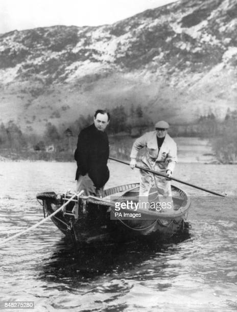 Forced to take to a rowing boat instead of his highspeed craft 'Bluebird' owing to a lastminute hitch Donald Campbell and his chief mechanic Leo...