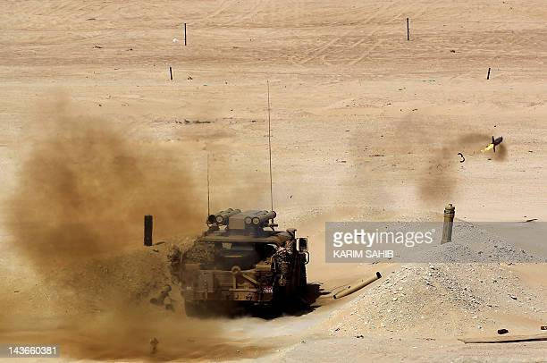 UAE forces fire a rocket during joint military manoeuvres with the French army in the desert of Abu Dhabi May 2 2012 AFP PHOTO/KARIM SAHIB