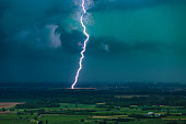 Strong lightning discharge in the night sky of Italian  town