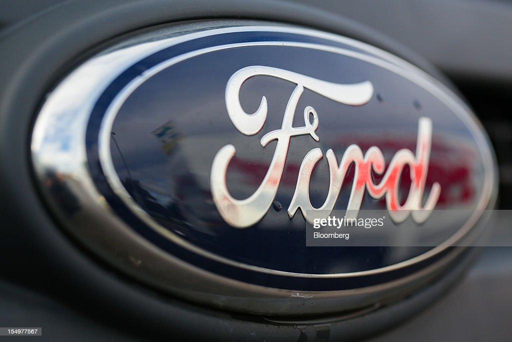 A Ford badge is seen on a Transit van produced by the Ford Motor Co., at the company's assembly plant in Southampton, U.K., on Monday, Oct. 29, 2012. Ford Motor Co. will shut three European plants, its first factory closings in the region in a decade, and cut 5,700 jobs to stem losses that the carmaker predicts will total more than $3 billion over two years. Photographer: Jason Alden/Bloomberg via Getty Images