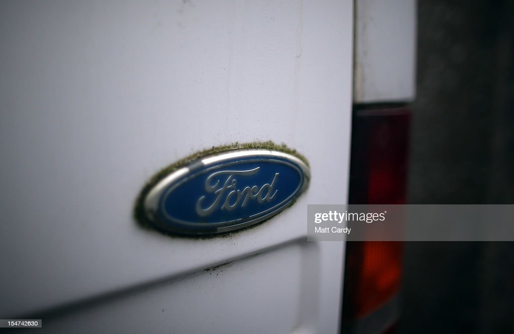 Ford badges are seen on a bonnet of a old Ford Transit van in a scrapyard on October 25, 2012 in Southampton, England. It was announced today that carmaker Ford plans to close two UK plants next year, one in Southampton, which has been making Transit vans since 1972, and one in Dagenham, with the loss of up to 1400 jobs.