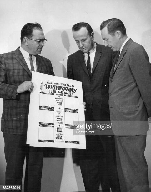 Ford Campaign Three members of the steering committee for Greater Denver Ford Dealers look over part of newspaper advertising for their joint...