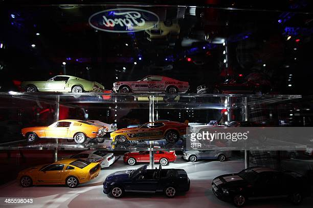 Ford car models are seen on display at the 50 years celebration ceremony of Ford Mustang in Beijing on April 19 ahead of the 'Auto China 2014'...
