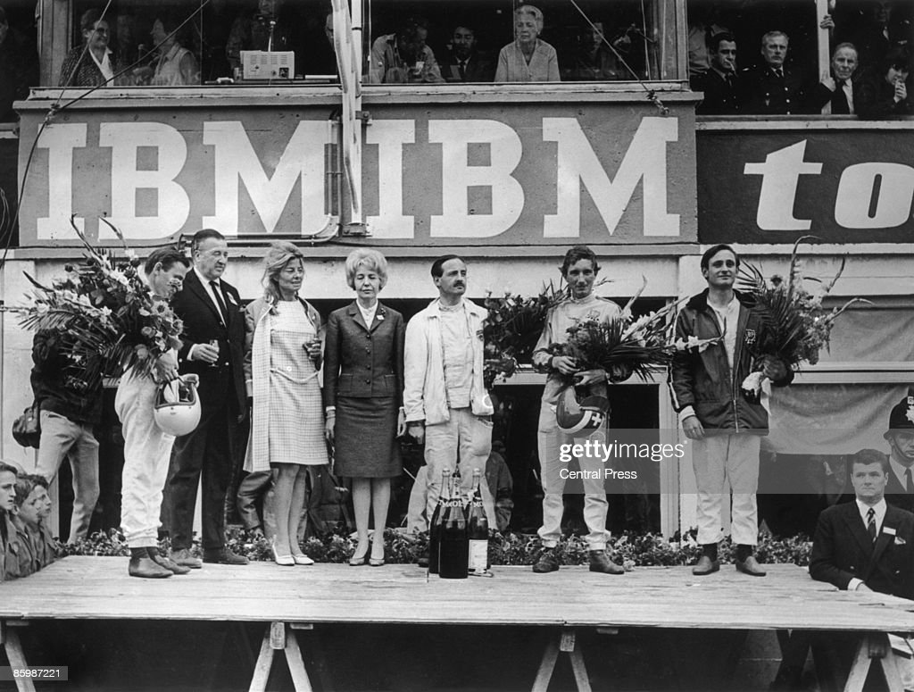 Ford CEO Henry Ford II with Ford drivers after their success in Ford GT40 MkII cars at the 24 Hours of Le Mans France 19th June 1966 On the podium...