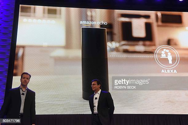 Ford CEO Mark Fields and Greg Hart Ford's vice president for Amazon Echo and Alexa Voice Services speak at a press conference on CES Press Day...