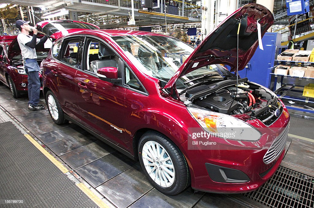 A Ford C-MAX hybrid vehicle goes through assembly at the Michigan Assembly Plant November 8, 2012 in Wayne, Michigan. The plant is the only one in the world that builds vehicles with five different fuel efficient powertrains on the same line. Ford held an event today at the plant that celebrated the launch of the C-MAX Energi plug-in hybrid.