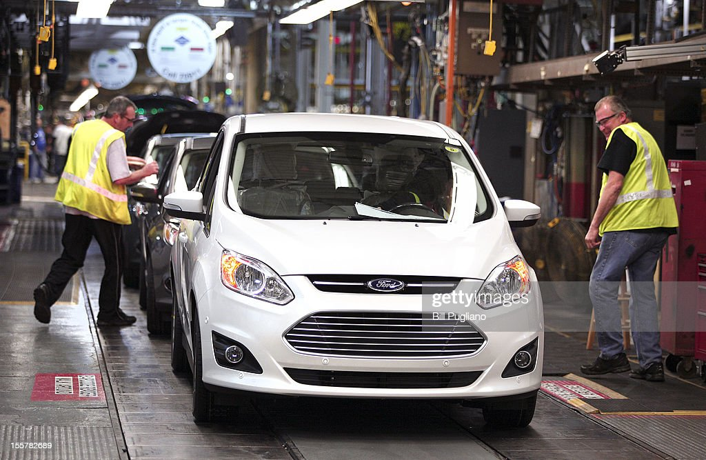 A Ford C-MAX plug-in hybrid vehicle comes off the assembly line at the Michigan Assembly Plant November 8, 2012 in Wayne, Michigan. The plant is the only one in the world that builds vehicles with five different fuel efficient powertrains on the same line. Ford held an event today at the plant that celebrated the launch of the C-MAX Energi plug-in hybrid.