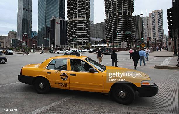 Ford Crown Victoria being used as a taxi navigates the city streets on September 8 2011 in Chicago Illinois Last month Ford saw sales of the Crown...