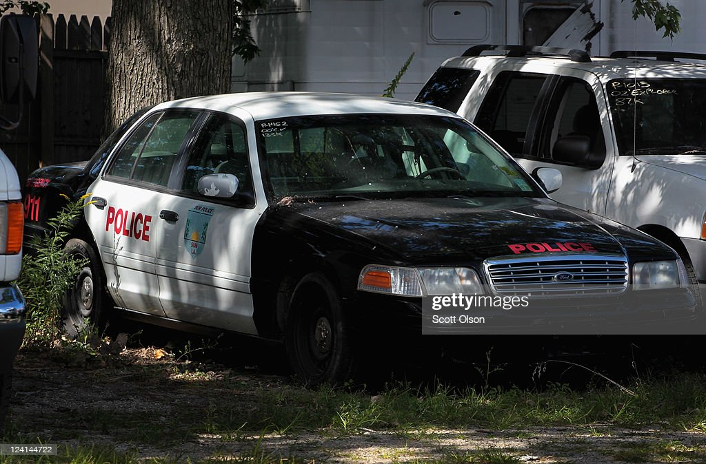 A Ford Crown Victoria once used as a police car sits in a used : crown ford used cars - markmcfarlin.com
