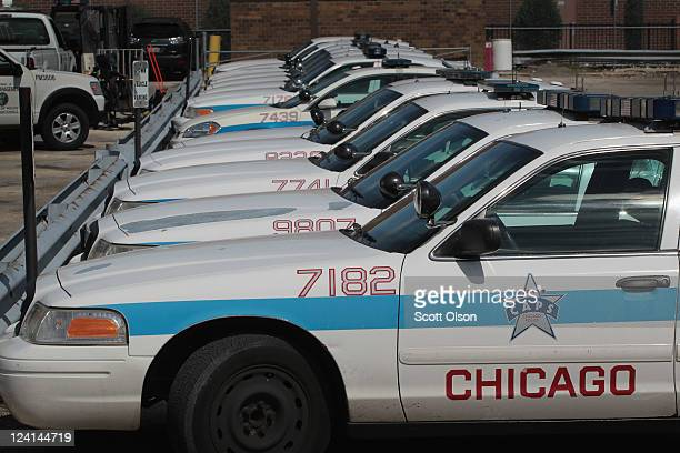 Ford Crown Victorias being used as Chicago police cars sit in a parking lot outside a police station September 8 2011 in Chicago Illinois Last month...