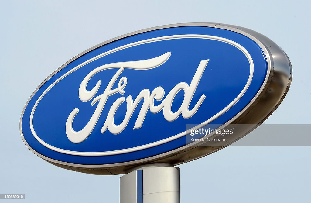 A Ford dealership sign is seen on January 29, 2013 in Glendale, California. According to reports the nation's second-largest automaker earned $1.7 billion in the fourth-quarter quarter, the highest pre-tax profit in a decade, up 55% from a year earlier. For the year, earnings slipped 5% to $5.7 billion.