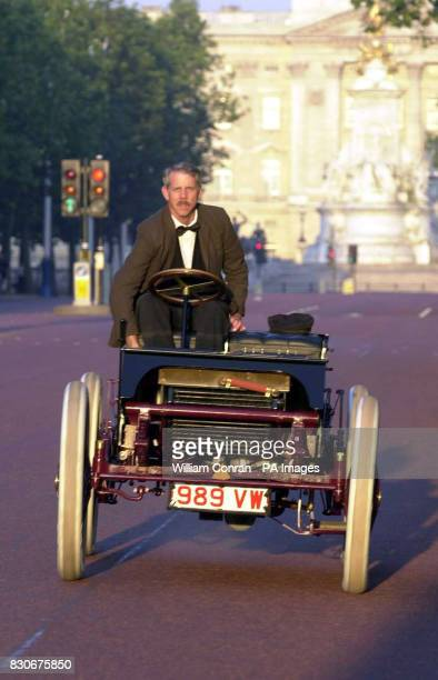 Ford engineer Glenn Miller drives a replica of the famous racing car 'Sweepstakes' down The Mall in London 'Sweepstakes' was the car that Henry Ford...