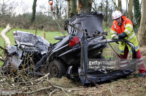 A Ford Escort car lies at the side of the road after crashing into a tree on the Ballyhill road outside Crumlin Co Antrim