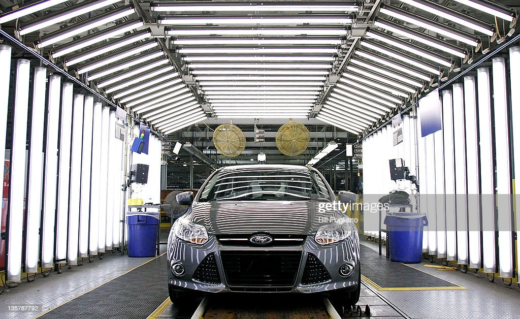 A Ford Focus goes through quality inspection on the assembly line at Ford Motor Co.'s Michigan Assembly Plant December 14, 2011 in Wayne, Michigan. Ford released details about the electrification of the Michigan Assembly Plant that will power production in part by one of the largest solar energy generator systems in order to produce their new C-MAX Hybrid and C-MAX Energi electric vehicles.