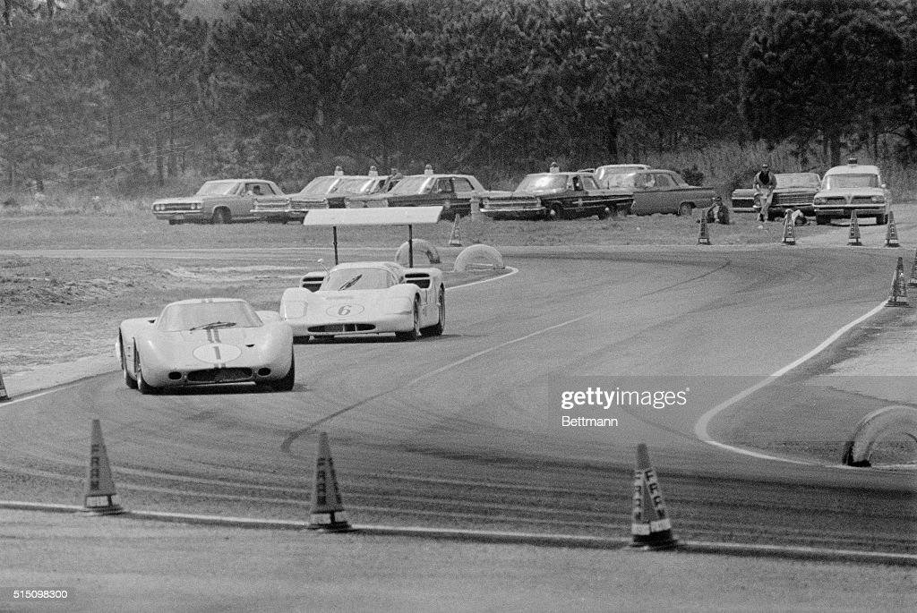 A Ford GT Prototype driven by Marion Andretti and an airbrakeequipped Chaparral with Jim Hall behind the wheel are shown as they battle for the lead...