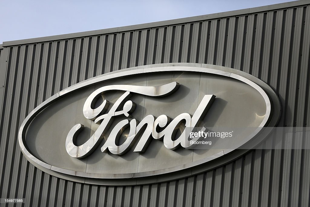 A Ford logo is seen on a stamping operations building at the Ford Motor Co. automobile factory in Dagenham, U.K., on Monday, Oct. 29, 2012. Ford Motor Co. will shut three European plants, its first factory closings in the region in a decade, and cut 5,700 jobs to stem losses that the carmaker predicts will total more than $3 billion over two years. Photographer: Simon Dawson/Bloomberg via Getty Images