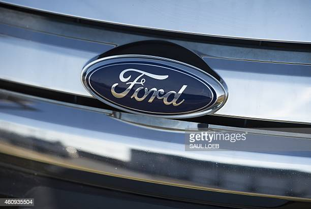 A Ford logo is seen on the hood of a car at an automotive dealership in Landover Hills Maryland December 31 2014 AFP PHOTO / SAUL LOEB