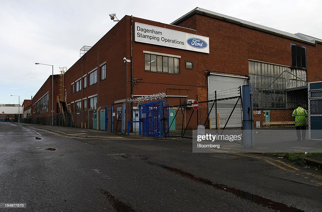 A Ford logo sits near a security entrance to the stamping operations area at the Ford Motor Co. automobile plant in Dagenham, U.K., on Monday, Oct. 29, 2012. Ford Motor Co. will shut three European plants, its first factory closings in the region in a decade, and cut 5,700 jobs to stem losses that the carmaker predicts will total more than $3 billion over two years. Photographer: Simon Dawson/Bloomberg via Getty Images