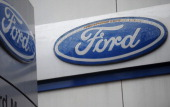Ford logos are seen in front of a Ford showroom in Manila on June 27 2012 US auto giant Ford said on June 27 it is to close its vehicle assembly...