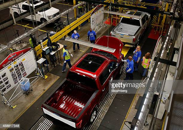 Ford Motor Co F150 trucks move along the production line at the company's Dearborn Truck Assembly facility in Dearborn Michigan US on Tuesday Nov 11...