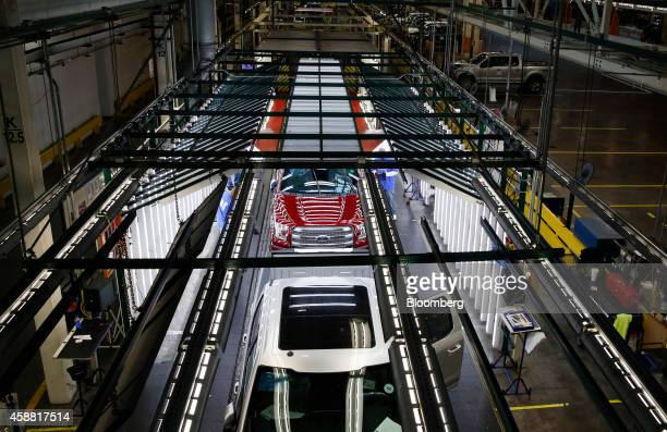 Ford Motor Co F150 trucks move through the inspection area on the production line at the company's Dearborn Truck Assembly facility in Dearborn...