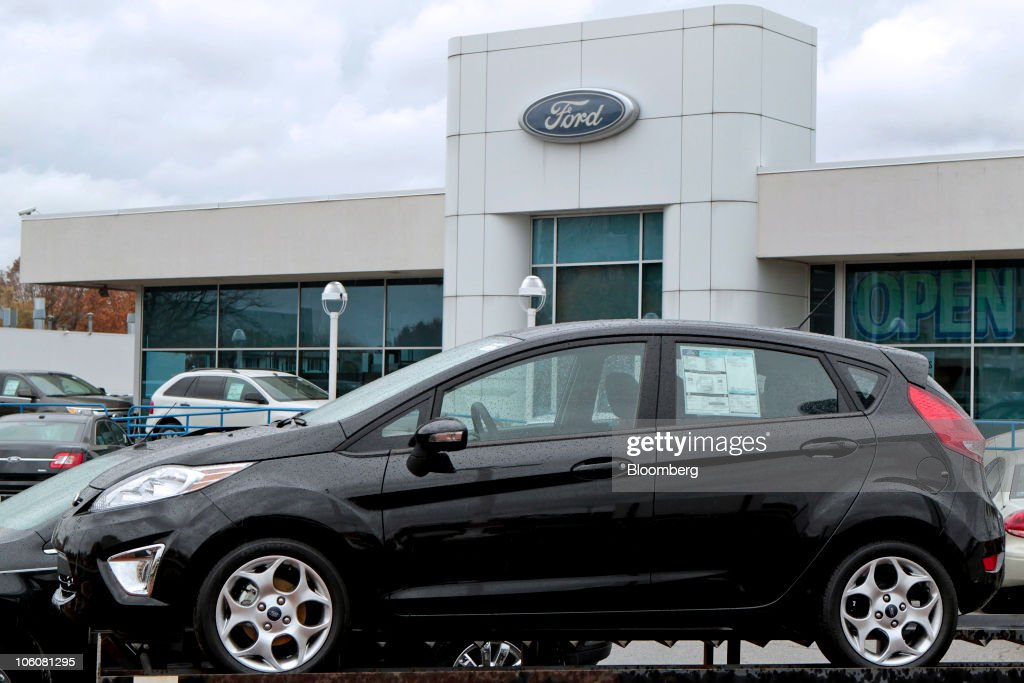 A Ford Motor Co. Focus compact car sits on the dealership lot at Avis Ford & Ford Posts Record $1.69 Billion Third-Quarter Profit Photos and ... markmcfarlin.com