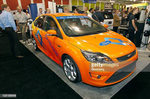 A Ford Motor Co Focus Electric vehicle sits on display at the PlugIn 2010 event in San Jose California US on Tuesday July 27 2010 Ford Motor Co chose...